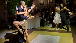 President Barack Obama and first lady Michelle Obama dance the tango with tango dancers during the State Dinner at the Centro Cultural Kirchner, Wednesday, March 23, 2016, in Buenos Aires, Argentina. (AP Photo/Pablo Martinez Monsivais)