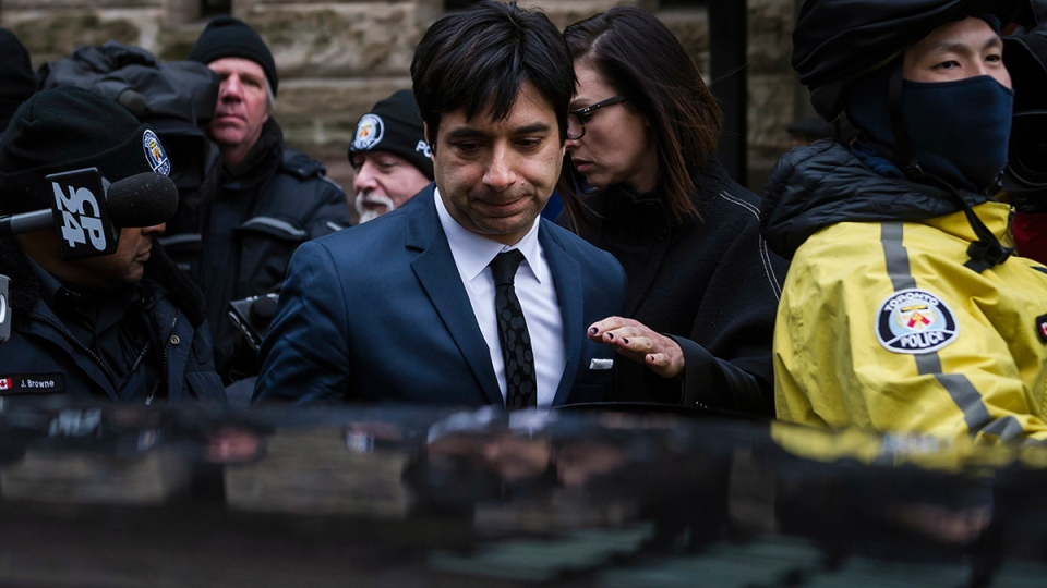 Jian Ghomeshi leaves court in Toronto on Thursday, March 24, 2016. (Christopher Katsarov / THE CANADIAN PRESS)