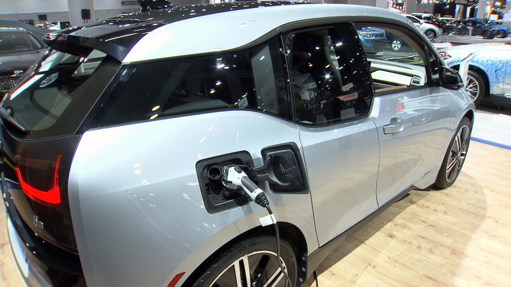 An electric car getting charged. File