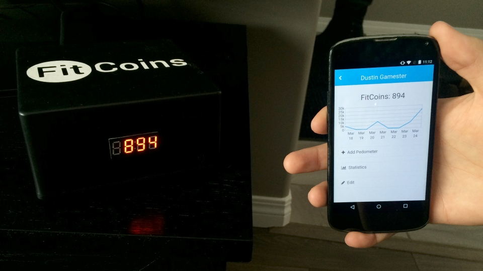 Dustin Gamester shows his FitCoins balance. The software rewards user's with points, or FitCoins, for exercise. The points decrease with screen time. (Angelina Irinici/CTV Saskatoon)