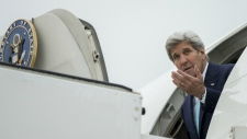 John Kerry arrives in Brussels