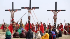 Filipino penitents are nailed to wooden crosses