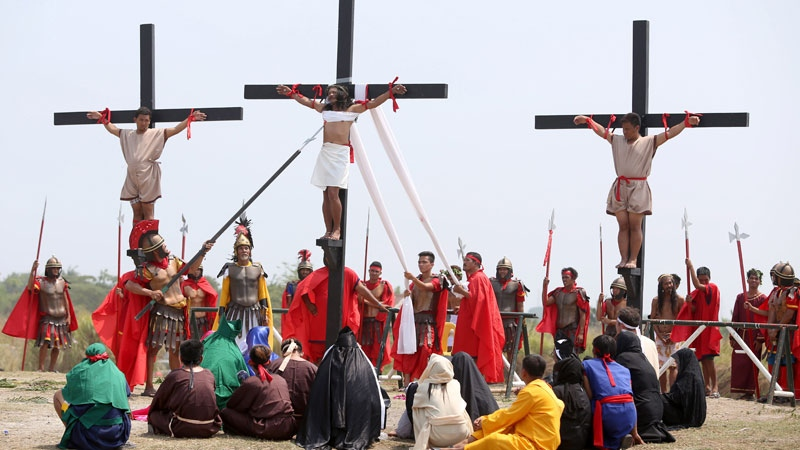 Filipino penitents are nailed to wooden crosses during a reenactment during Good Friday rituals on Friday, April 25, 2016 at Cutud, Pampanga province, northern Philippines. Several Filipino devotees had themselves nailed to crosses Friday to remember Jesus Christ's suffering and death, an annual rite frowned upon by church leaders in this predominantly Roman Catholic country. (AP /Linus Escandor II)
