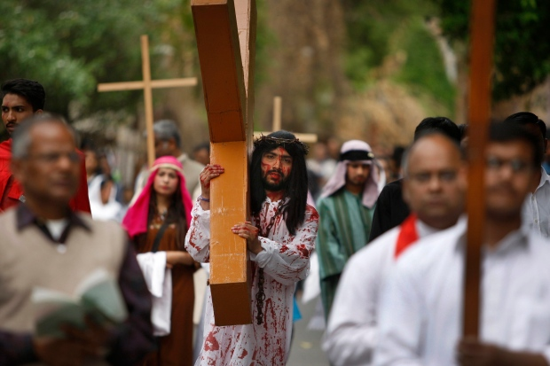 Indian actors reenact the crucifixion of Jesus Christ during a Good Friday procession in Jammu, India, Friday, March 25, 2016. (AP Photo/Channi Anand)