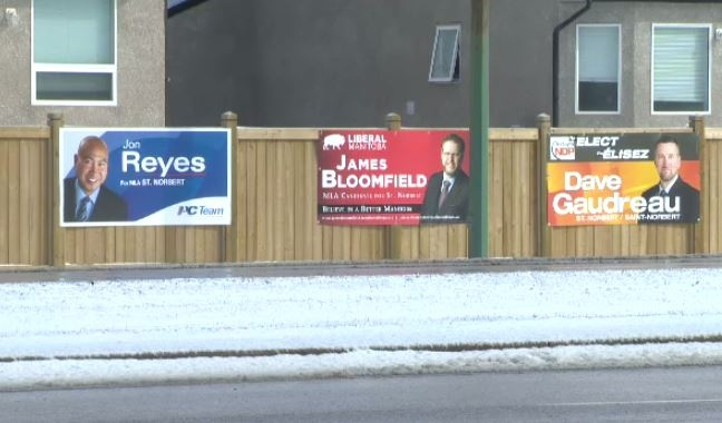 Signs for three of the candidates for the St. Norbert seat in the Manitoba Legislature.