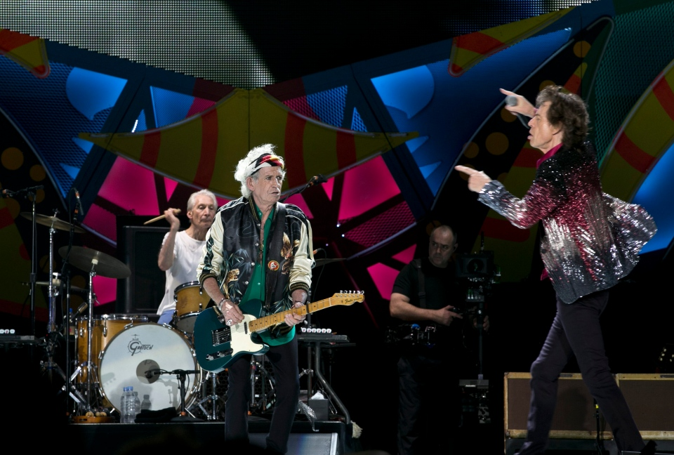 Mick Jagger, right, of the The Rolling Stones performs as Keith Richards plays the guitar and Charlie Watts plays the drums, in Havana, Cuba, Friday March 25, 2016. (AP / Enric Marti)