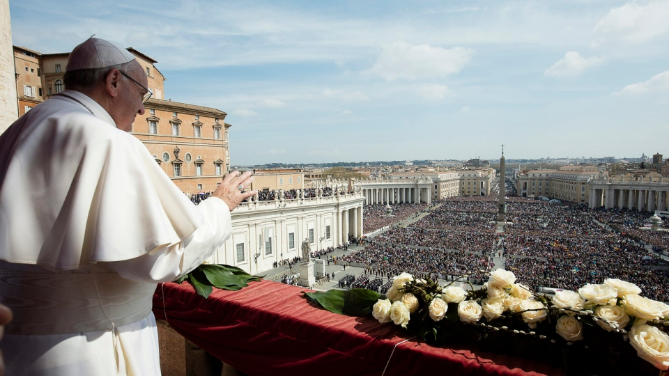 Pope Francis delivers the Urbi et Orbi (to the city and to the world) message at end of the Easter mass, in St. Peter's Square, at the Vatican, Sunday, March 27, 2016. (L'Osservatore Romano/pool photo via AP)