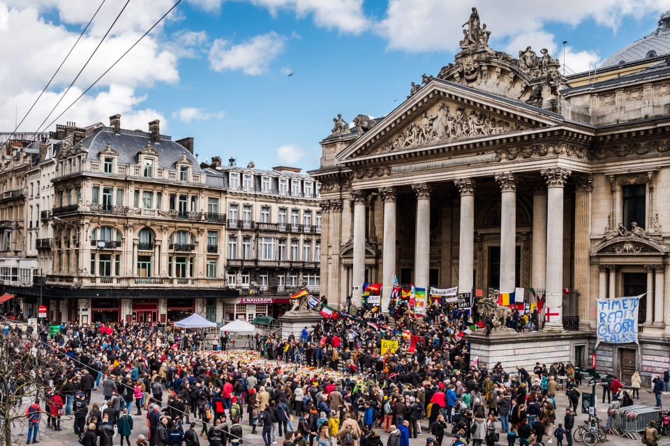 People gather at a memorial site at the Place de la Bourse in Brussels, Sunday, March 27, 2016. (AP/Geert Vanden Wijngaert)