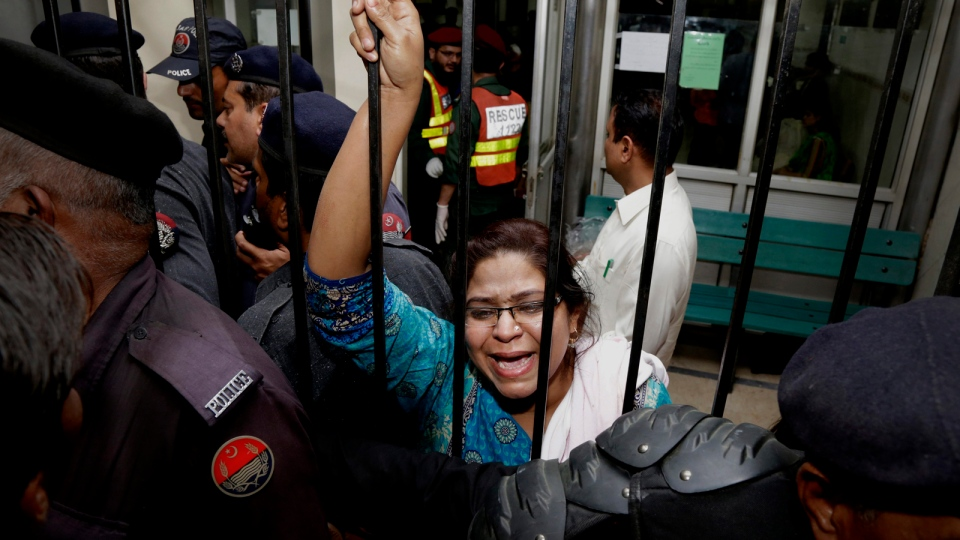 A woman weeps for her injured family members as she tries to speak to security at a local hospital in Lahore, Pakistan, Sunday, March, 27, 2016. (AP / K.M. Chuadary)