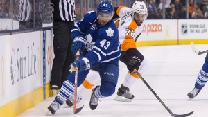 Toronto Maple Leafs' centre Nazem Kadri (43) drives the puck past Philadelphia Flyers' Pierre-Edouard Bellemare during second period NHL hockey action, in Toronto on Saturday, Feb. 20, 2016. (THE CANADIAN PRESS / Chris Young)