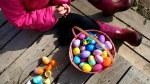 Jessie Liningen, 8, opens an egg after an Easter egg hunt at The Olde World Village in Augusta, Mich., Saturday, March 26, 2016. (Chelsea Purgahn / Kalamazoo Gazette-MLive Media Group via AP)