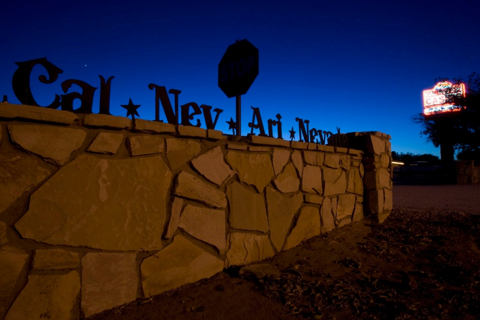 A sign is shown Wednesday, July 7, 2010, in Cal-Nev-Ari, Nev., a town of about 300 residents 70 miles south of Las Vegas on U.S. Highway 95. Much of the town is for sale including a casino, motel RV and mobile home park, residential lots and vacant land. (AP Photo/Las Vegas Review-Journal, K.M. Cannon)