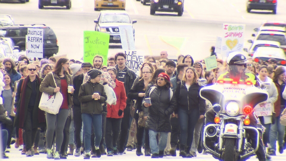 Hundreds of protesters marched up Commercial Drive on Sunday in solidarity with the women who accused former CBC host Jian Ghomeshi of sexual assault and choking. (CTV)