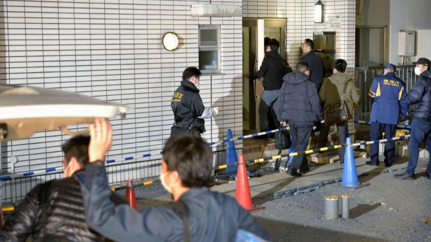 Police officers arrive for investigation of the apartment of abduction suspect Kabu Terauchi in Tokyo on Monday, March 28, 2016. (Kyodo News)