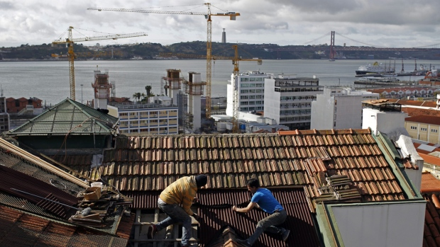 Repairing a roof in Lisbon, Portugal