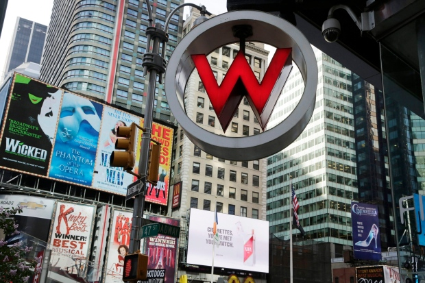 In this Wednesday, July 31, 2013, file photo, the logo for the W Hotel, owned by Starwood Hotels & Resorts Worldwide, is seen in New York's Times Square. (AP/Mark Lennihan)