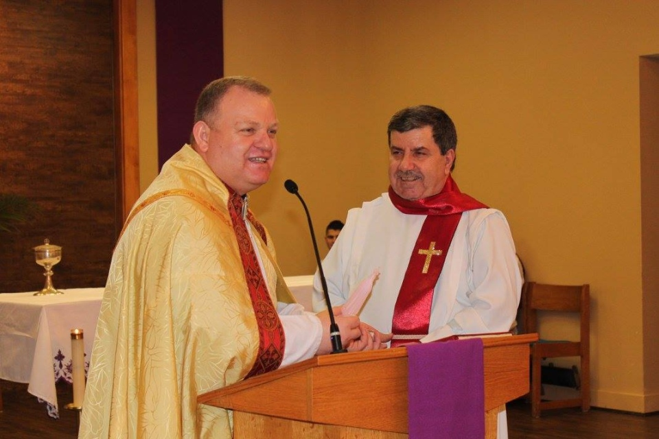 Father Amer Saka (left) with the St. Joseph Chaldean Catholic Church in London, Ontario. (St. Joseph Chaldean Church Facebook Page)
