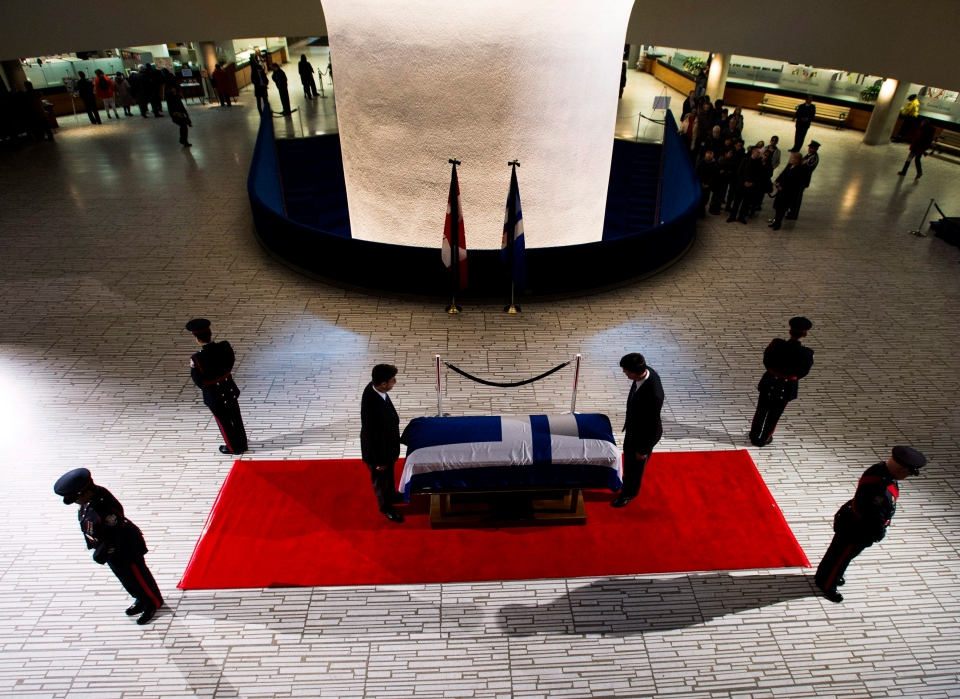 An honour guard is seen at former Toronto mayor Rob Ford's casket at city hall on Monday, March 28, 2016. (Nathan Denette / THE CANADIAN PRESS)