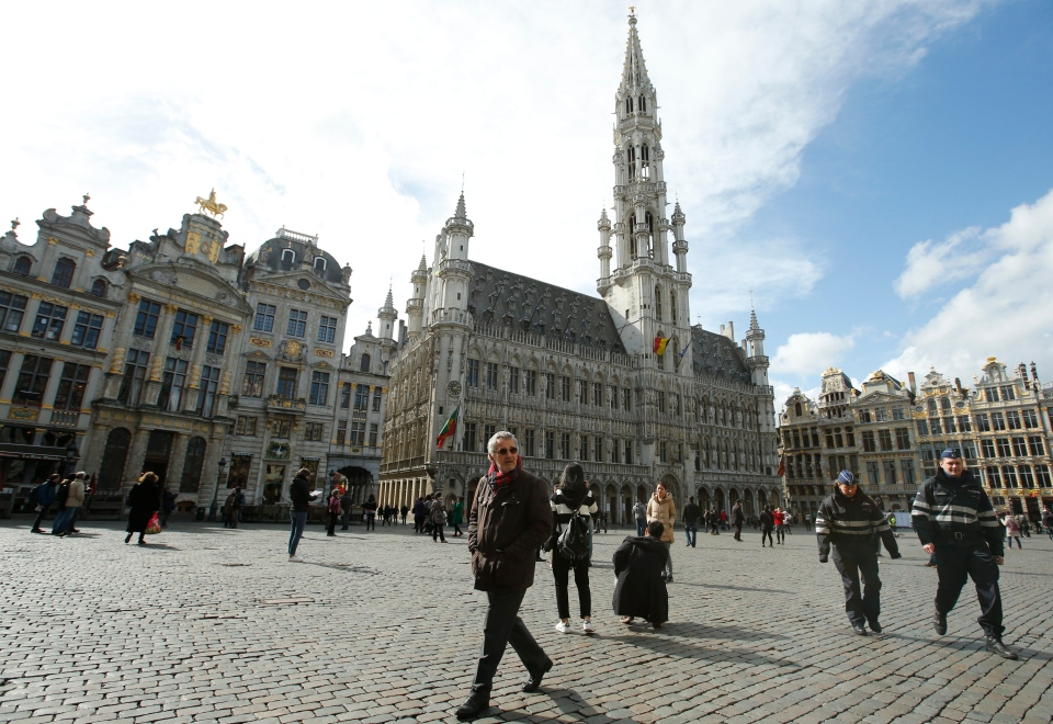 Police patrol through the Grand Place, as tourists wander in Brussels, Monday, March, 28, 2016. (AP / Alastair Grant)