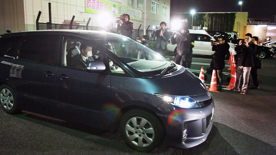 A police car carrying a girl who had been abducted, leaves the police headquarters in Niiza, Saitama Prefecture, near Tokyo, Sunday, March 27, 2016. (Kyodo News)