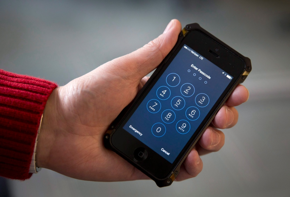 The FBI says it has successfully broken into a locked iPhone, ending a legal dispute with Apple. In this photo an iPhone is seen in Washington on from Feb. 17, 2016. (AP / Carolyn Kaster)