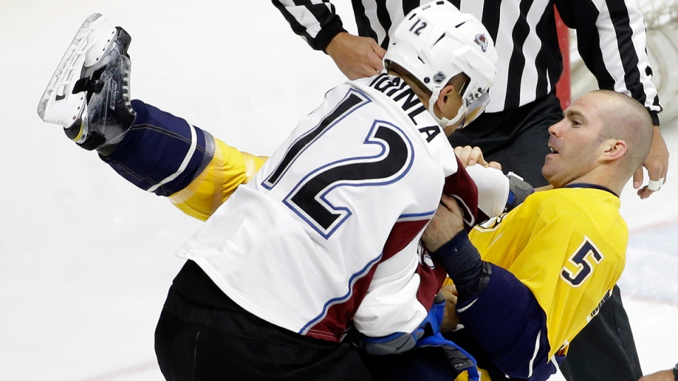 Colorado Avalanche right wing Jarome Iginla (12) takes down Nashville Predators defenceman Barret Jackman (5) during a fight in the first period of an NHL hockey game, in Nashville, Tenn., Monday, March 28, 2016. (AP / Mark Humphrey)