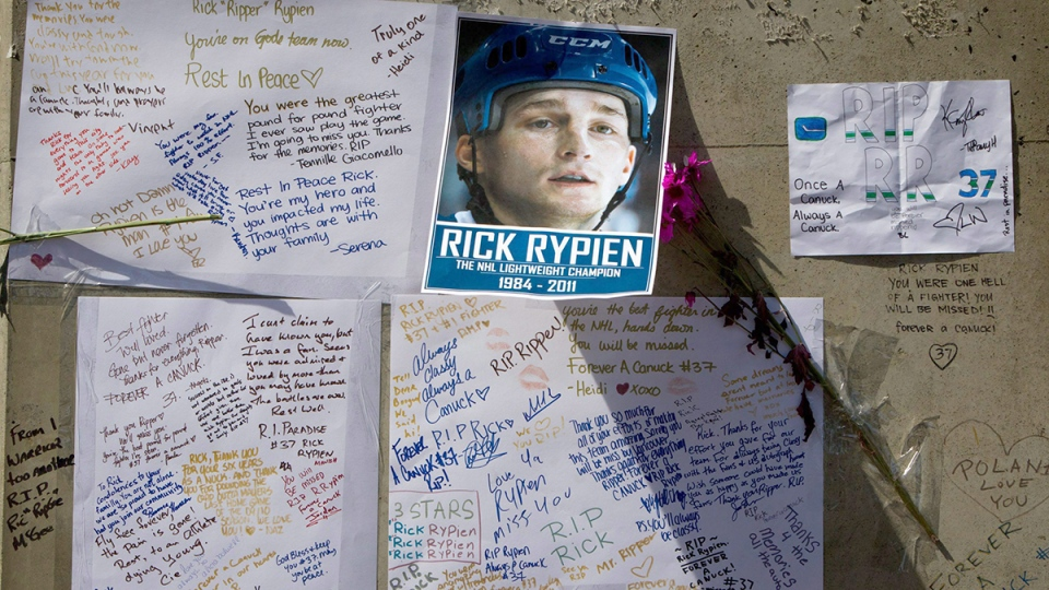 Messages left by fans are pictured at a makeshift memorial to honour former Vancouver Canucks hockey player Rick Rypien outside Rogers Arena in Vancouver, on Wednesday, Aug. 17, 2011. (Darryl Dyck / THE CANADIAN PRESS)