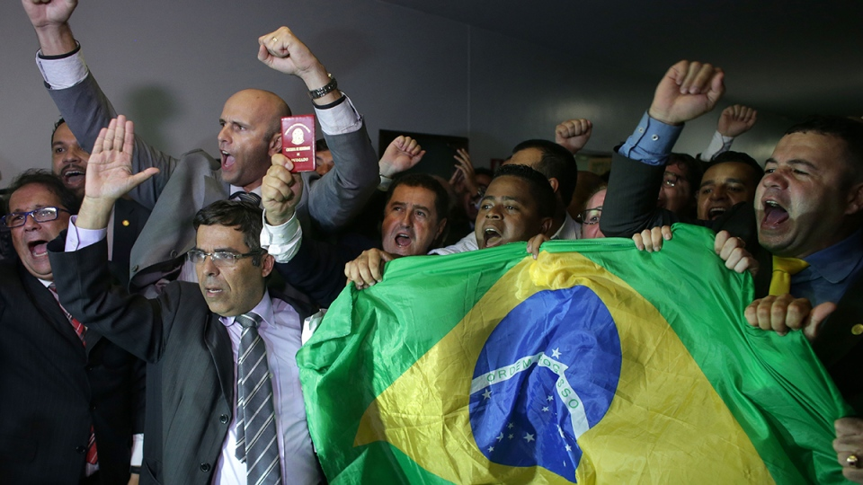 Lawyers from Brazil's Bar Association shout slogans, showing their support to impeach Brazil's President Dilma Rousseff, inside the National Congress in Brasilia, Monday, March 28, 2016. (AP / Eraldo Peres)