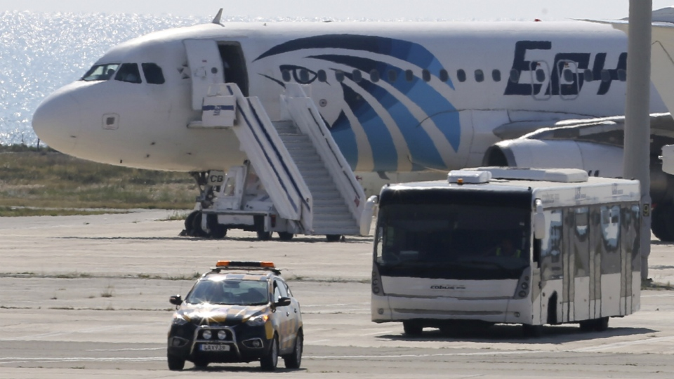 A bus carrying some passengers from the hijacked EgyptAir aircraft as at it landed at Larnaca airport on Tuesday, March 29, 2016. (AP / Petros Karadjias)