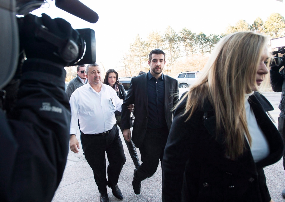 Marco Muzzo, centre, arrives with family at the court house for his sentencing hearing in Newmarket, Ont., on Tuesday, February 23, 2016. Muzzo, 29, pleaded guilty earlier this month to four counts of impaired driving causing death and two of impaired driving causing bodily harm. THE CANADIAN PRESS/Nathan Denette