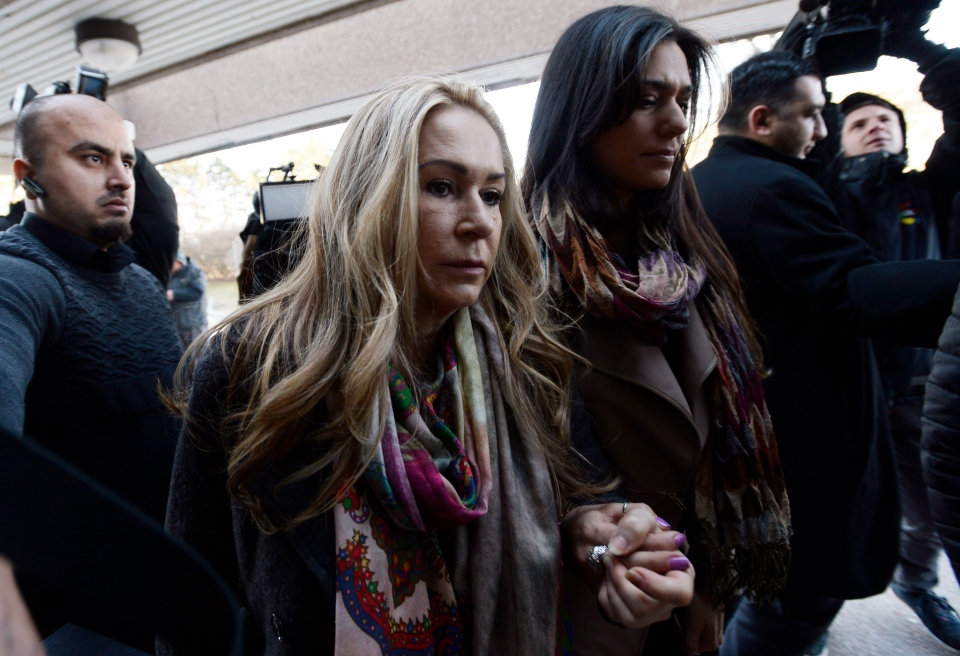 Dawn Muzzo, centre, mother of accused drunk driver Marco Muzzo, and his fiancee Taryn Hampton, centre right, arrive at court in Newmarket, Ont., on Tuesday, March 29, 2016. (Nathan Denette / THE CANADIAN PRESS)