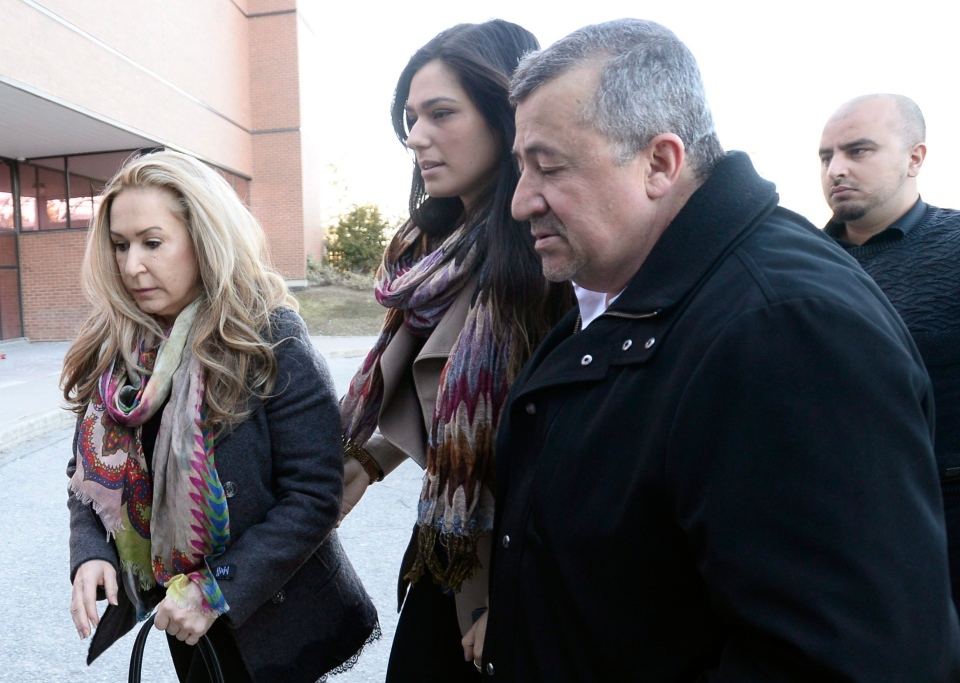 Dawn Muzzo, left, mother of accused drunk driver Marco Muzzo, and his fiancee Taryn Hampton, centre, arrive at court in Newmarket, Ont., on Tuesday, March 29, 2016. Marco Muzzo, who killed three children and their grandfather in a horrific crash north of Toronto, will be sentenced Tuesday.THE CANADIAN PRESS/Nathan Denette