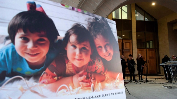 A photo of the Neville-Lake children, killed in a fatal drunk driving accident in September, is seen as people gathered for a candlelight vigil at St. Padre Pio Church in Kleinburg. (Marta Iwanek/THE CANADIAN PRESS)