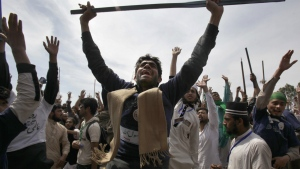 Protesters from Pakistan's Sunni Tehreek group chant slogans during a sit-in near the parliament building in Islamabad, Pakistan, Tuesday, March 29, 2016. (AP / Anjum Naveed)