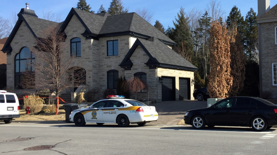 Police raided this house on Prucheraie St. in Ste. Marthe sur le lac on March 30, 2016 (CTV Montreal/Jean-Luc Boulch)