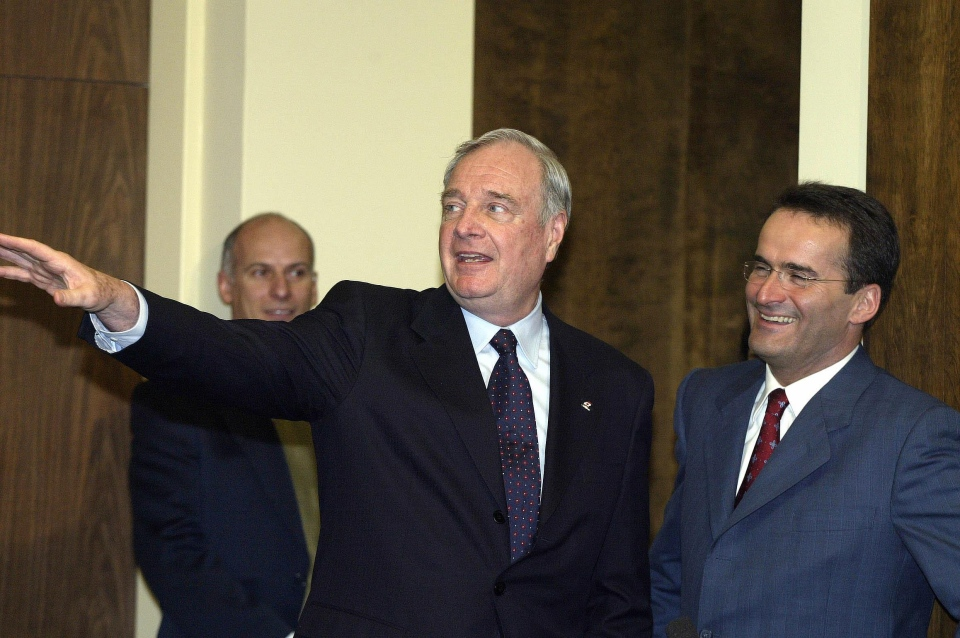 In this file photo, Prime Minister Paul Martin responds to media questions as candidate Jean Lapierre, right, looks on, following a meeting with local university officials in Sherbrooke Que., Tuesday March 16, 2004. (Jacques Boissinot / THE CANADIAN PRESS)