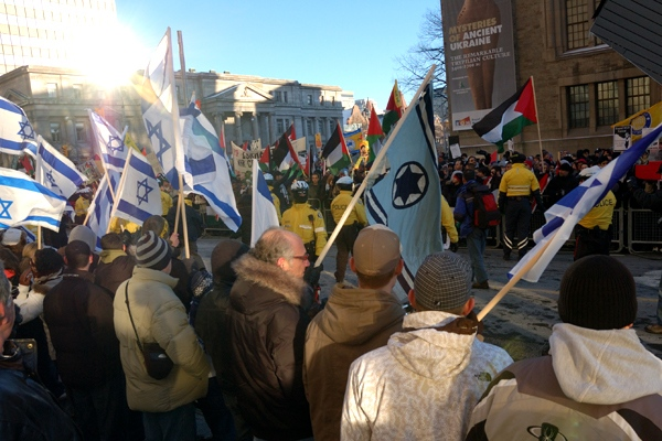 Pro-Palestinian and pro-Israeli protesters share their concerns during rallies in downtown Toronto, standing just a few metres apart. Toronto police were on hand to keep the peace. (Alex Grachtchouk / MyNews.CTV.ca)