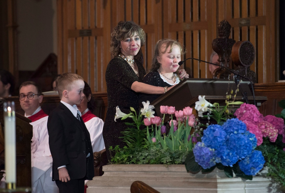 Former Toronto mayor Rob Ford's widow Renata and son Dougie look on as daughter Stephanie speaks at her father's funeral at St. James Cathedral in Toronto, Wednesday, March 30, 2016. (Nathan Denette / THE CANADIAN PRESS)