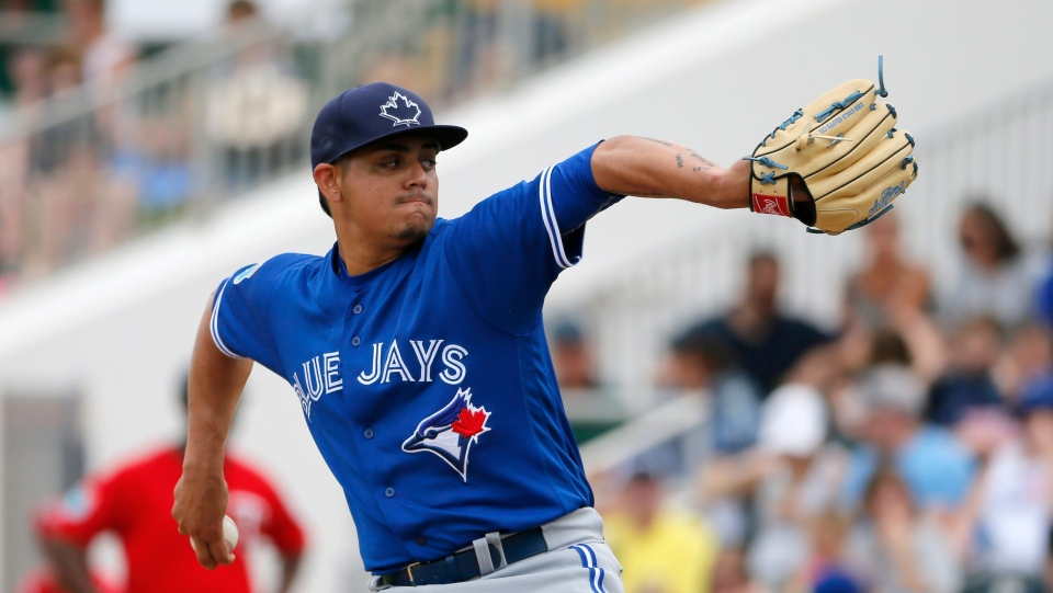 Toronto Blue Jays relief pitcher Roberto Osuna works against the Minnesota Twins in the fifth inning of a spring training baseball game on March 30, 2016, in Fort Myers, Fla. (Tony Gutierrez / AP Photo)