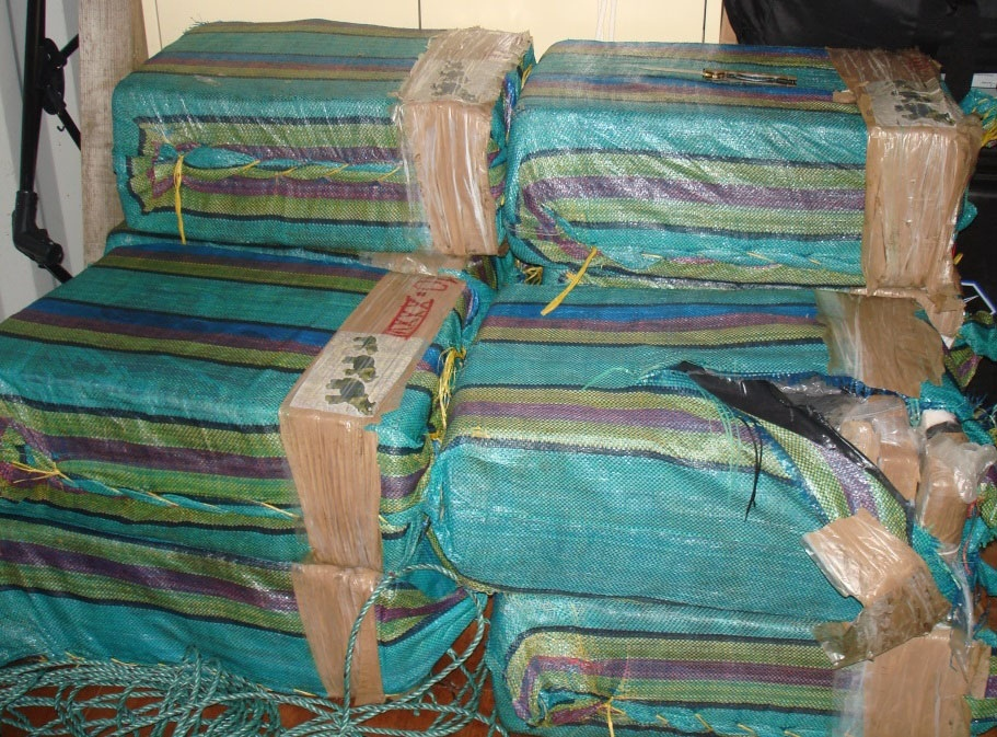 Bales of cocaine jettisoned from a suspected smuggling boat and retrieved from the Eastern Pacific Ocean lie stacked aboard HMCS Saskatoon during a patrol March 20, 2016. The bales were seized by a U.S. Coast Guard Law Enforcement Detachment embarked on HMCS Saskatoon. (U.S. Coast Guard)