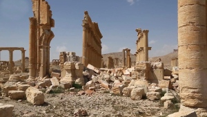 This photo released on Monday March 28, 2016, by the Syrian official news agency SANA, shows some damage at the ancient ruins of Palmyra, central Syria. (SANA via AP)