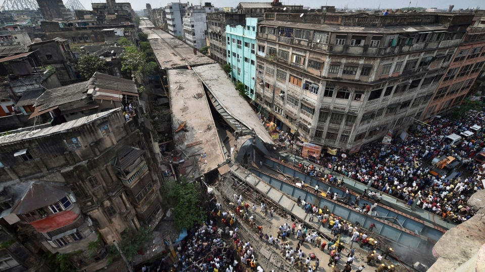 Locals and rescue workers clear the rubbles of a partially collapsed overpass in Kolkata, India, Thursday, March 31, 2016. (Swapan Mahapatra/Press Trust of India via AP)
