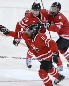 Team Canada members race to congratulate defenceman P K Subban on his first period goal against Team Sweden in Ottawa, on Monday, Jan. 5, 2009. (Tom Hanson / THE CANADIAN PRESS)