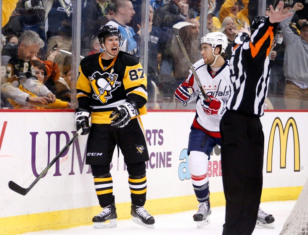 Pittsburgh Penguins' Sidney Crosby (87) reacts to referee Kendrick Nicholson (44) waving off his goal during the second period of an NHL hockey game with Washington Capitals' Tom Wilson (43) defending in Pittsburgh on March 20, 2016. (Gene J. Puskar / AP Photo)