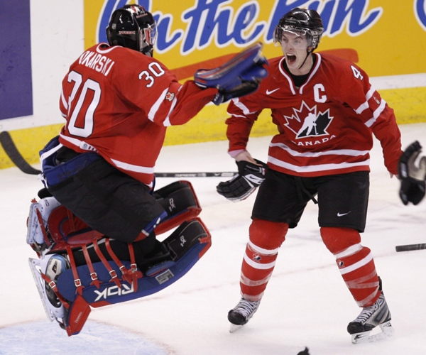 Team Canada's defenceman Thomas Hickey races to celebrate with goalie Dustin Tokarski after defeating Sweden at the world junior hockey championship in Ottawa on Monday, Jan. 5, 2009. (Adrian Wyld / THE CANADIAN PRESS)