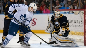 Toronto Maple Leafs center Colin Greening (38) deflects the puck as Buffalo Sabres goaltender Chad Johnson (31) and defenseman Rasmus Ristolainen, left, defend during the second period of an NHL hockey game, Thursday, March 31, 2016, in Buffalo, N.Y. (AP Photo / Gary Wiepert)