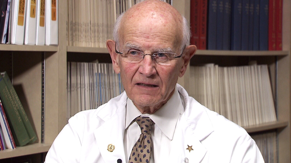 Neurosurgeon Dr. Charles Tator speaks about the effects of concussions on NHL players, at his office in Toronto.