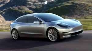 This undated photo provided by Tesla Motors shows the Model 3 car. (Tesla Motors via AP)