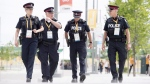 Police officers walk through the athletes' village at the 2015 Pan Am Games in Toronto on July 9, 2015. (THE CANADIAN PRESS/Darren Calabrese)