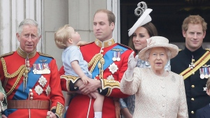 Prince William holds his son Prince George, with Queen Elizabeth II, 2nd right, Kate, Duchess of Cambridge, the Prince of Wales, left, and Prince Harry, right, at Buckingham Palace on June 13, 2015. (Tim Ireland / AP)